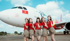 Vietjet_s Cabin Crew in front of the Vietnamese Tourism branded aircraft.jpg